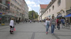 Neuhauser Strasse with shops and flags in Munich Stock Footage