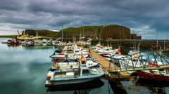 4K TimeLapse.  Drifting boats at the dock on a cloudy day Stock Footage