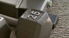 Close up of barbells on gym floor - stock footage