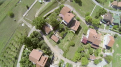 AERIAL: Streets and houses in a small town Stock Footage