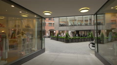 A beautiful interior courtyard with restaurants in Munich Stock Footage
