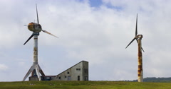 Timelapse Clouds With Old Rusty Windmills 4K Stock Footage