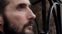 Homeless closeup portrait: man looking in the street  Stock Footage