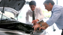 Businessman explaining the car details - stock footage