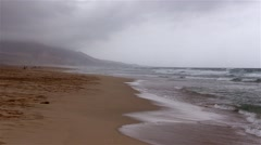 The beach in fog  in the area  Cofete on Fuerteventura Stock Footage
