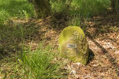 Historic boundary stone Germany Netherlands . - stock photo