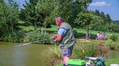 Fishing on pond coast Stock Footage