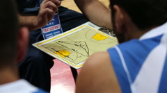 Coach explains the strategy of the game before the basketball match. Stock Footage