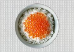 rice dish with red caviar - stock photo