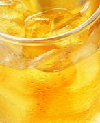 Glass of orange juice with ice - macro Stock Photos