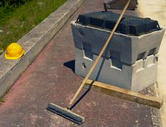 pit block precast concrete, helmet and scrubbing brush - stock photo