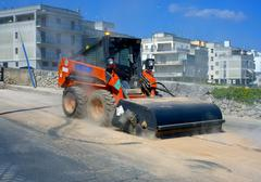 Sweeper attachments mini excavator. - stock photo