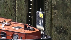 Floating bollard in lock chamber descending while the lock is emptied Stock Footage