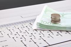 Money on keyboard Stock Photos