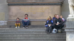 Sitting on the Feldherrnhalle's stairs in Munich Stock Footage
