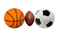 A group of sports balls on a white Stock Photos