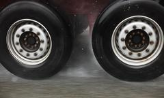 Stock Photo of truck wheels on road aquaplaning