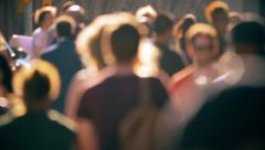 Unrecognisable anonymous crowd people pedestrians walking backlight defocused - stock footage