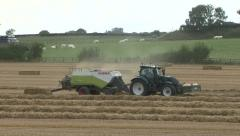 Stock Video Footage of Baler at work on wheat straw.