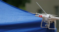 A white small drone on standby Stock Footage