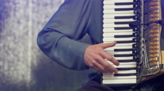 A finger masterfully strumming the accordion Stock Footage