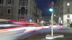 Panning shot of Nighttime time-lapse of a busy street in Rome. Stock Footage