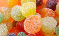 Fruit candy multi-colored all sorts, a background - stock photo