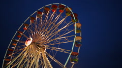 Ferris Wheel at amusement park at a night - stock footage