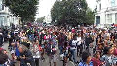 Notting Hill Carnival _ London Festival _  Crowd walking towards the camera Stock Footage