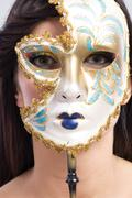 Beauty model girl with carnival mask Stock Photos