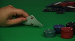 Stock Video Footage of Close up of Male Playing Card Game of Chance in Casino