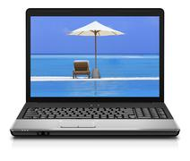 Computer notebook on beach - business travel background Stock Photos