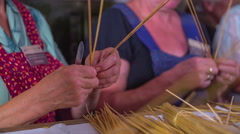 Skilfully weaving straw in skilful hands Stock Footage