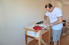 Man-diy renewing his living room - stock photo