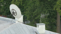 The antenna and the dish on the roof of the building - stock footage