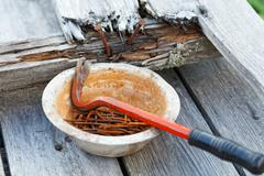 claw hammer and rusty nails on the old boards - stock photo