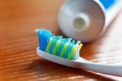 Toothbrush and toothpaste closeup Stock Photos