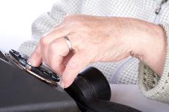 The hand  old woman dials  number of phone - stock photo