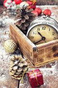retro arrangement for Christmas with an old alarm clock - stock photo