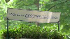 The geschirrabgabe of an outdoor restaurant in the English Garden of Munich Stock Footage