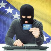 Concept of cybercrime with national flag on background - Bosnia and Herzegovi - stock photo