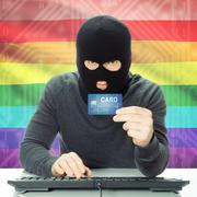 Concept of cybercrime with national flag on background - LGBT people - stock photo