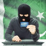 Concept of cybercrime with national flag on background - Pakistan - stock photo