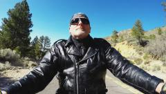 Low Angle Motorcyclist Selfie On Mountain Road With Pine Trees Stock Footage