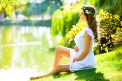 Beautiful pregnant woman feeling lovely Stock Photos