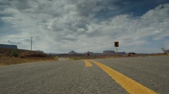 Road line dolly shot in Utah desert Stock Footage