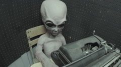 Grey Alien At Old School Typewriter- Roswell New Mexico Stock Footage