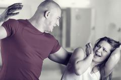 Woman victim of domestic violence and abuse. Husband beats his wife Stock Photos