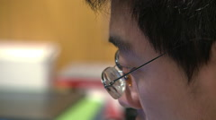 Close-up face of Chinese man working Stock Footage