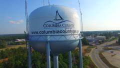 Columbia county GA Water Tower aerial Stock Footage